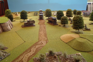 Lead Vehicles blasted off road by German machine guns.