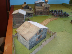 Close up of The Village.  A mix of purchased and scratch built buildings.