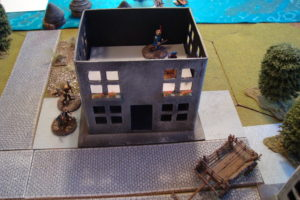 With Two Buildings Captured, Defenders In East Two-Story Building Await the Onslaught.
